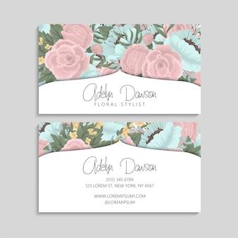 Tarjeta de visita con flores de color rosa y menta