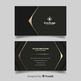 Tarjeta de visita negra y dorada con logo