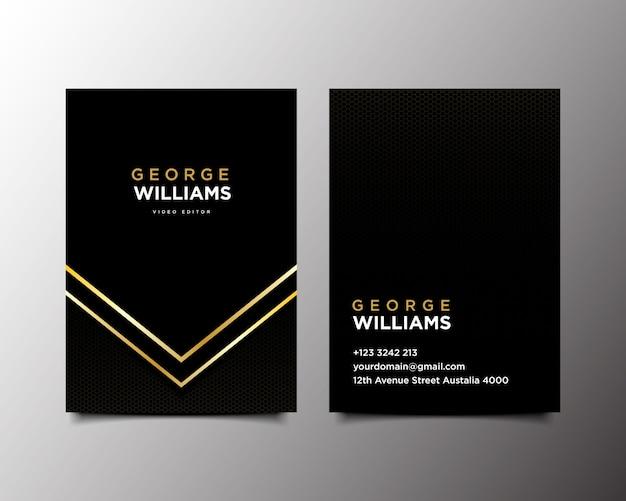 Tarjeta de visita negra y dorada.