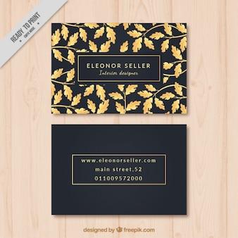 Tarjeta de visita negra con elementos dorados