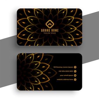 Tarjeta de visita negra de lujo con decoración dorada