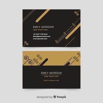 Tarjeta de visita negra con plantilla de elementos dorados