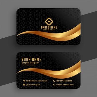 Tarjeta de visita ondulada dorada y negra premium
