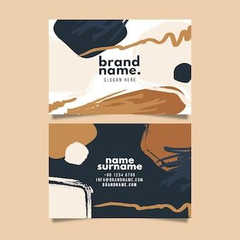 Tarjeta de visita pintada a mano en tonos marrones