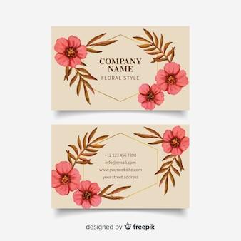 Tarjeta de visita con plantilla floral de líneas doradas