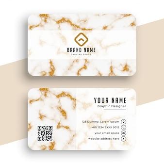 Tarjeta de visita de textura de mármol blanco y oro