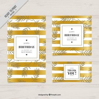 Tarjetas elegantes de cumpleaños con rayas doradas y hojas