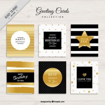 Tarjetas de felicitación decoradas con elementos dorados