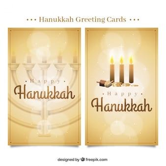 Tarjetas de felicitación doradas de hanukkah con efecto bokeh