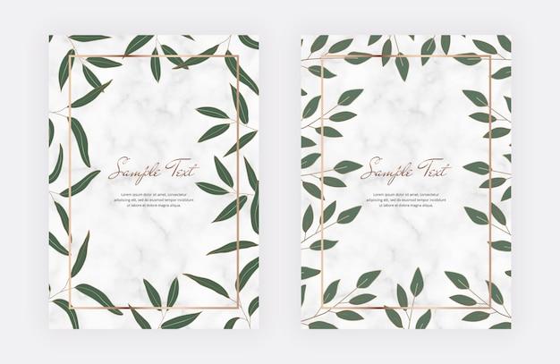Tarjetas de mármol con hojas verdes, marcos geométricos de líneas doradas.