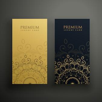 Tarjetas premium de mandala en colores oro y negro
