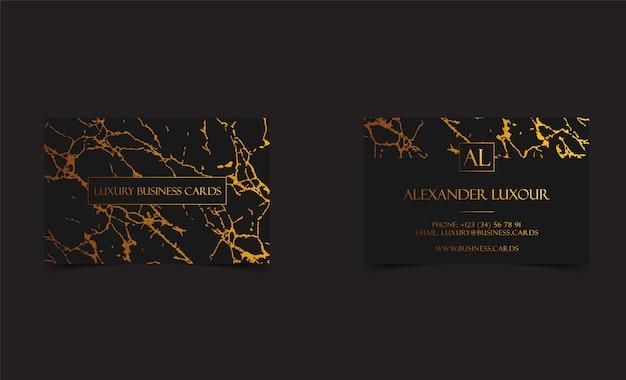 Tarjetas de visita negras de lujo con textura de mármol.