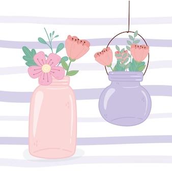 Tarros de albañil colgando flores rústicas