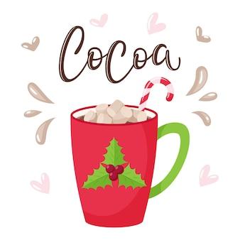 Taza con cacao, malvavisco y bastón de caramelo.taza roja con acebo. inscripción manuscrita-cacao. letras.