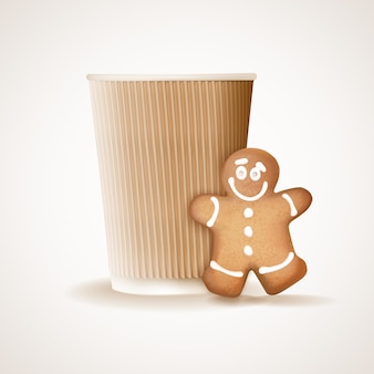 Taza de café de papel y hombre de jengibre
