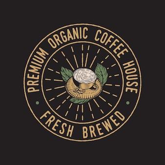 Taza de café vintage insignia emblema dibujado a mano
