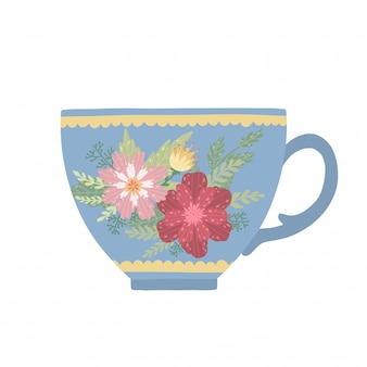 Taza de té hermosa con la flor y las hojas aisladas en el fondo blanco. taza elegante.