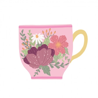Taza de té hermosa con la flor y las hojas aisladas en el fondo blanco.
