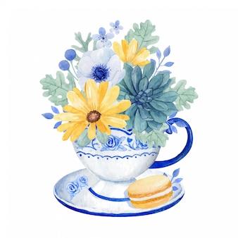 Taza de té vintage con un montón de hermosas flores, aster, anémona y suculentas en la taza de té con macarrones