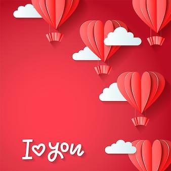 Te amo: diseño de tarjeta de felicitación del día de san valentín con papel cortado en forma de corazón rojo globos aerostáticos volando con nubes