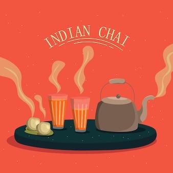 Té indio masala en vasos y hervidor servido con bocadillos calientes