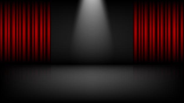 Teatro vacío o escenario de cine con cortinas rojas