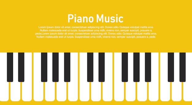 Teclado de piano blanco y negro sobre un amarillo.