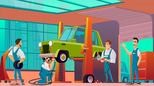 Técnicos de garaje que reemplazan ruedas o neumáticos en el automóvil