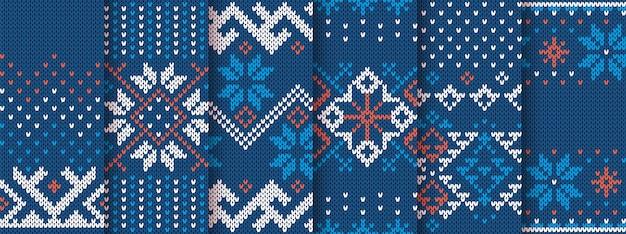 Tejer estampado sin costuras. patrón de navidad. textura de suéter de punto azul. establecer adornos navideños de la isla justa