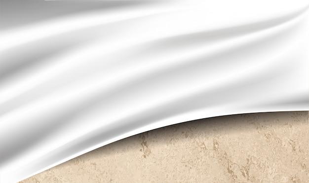Tela blanca sobre textura del desierto