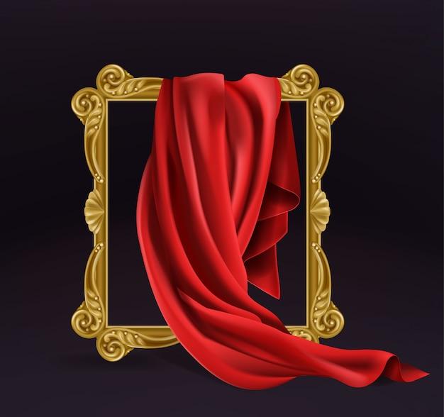 Tela de seda roja que cubre el marco de madera de la foto