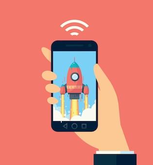 Teléfono en mano. la imagen del cohete en el teléfono. comunicación móvil rápida