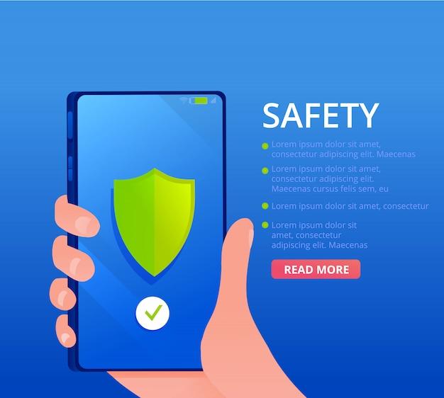El teléfono móvil en mano. escudo verde en una pantalla. una pancarta de seguridad