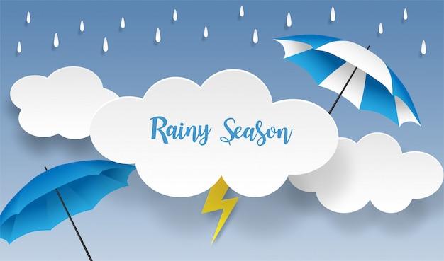 Temporada de lluvias. diseño con gotas de lluvia, paraguas y nubes sobre fondo azul. vector.