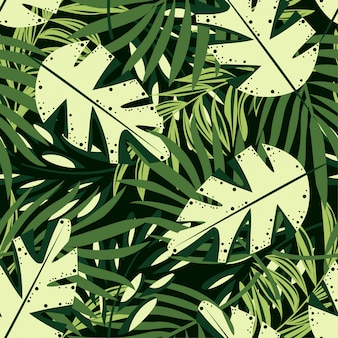 Tendencia de patrones sin fisuras con brillantes hojas y plantas tropicales