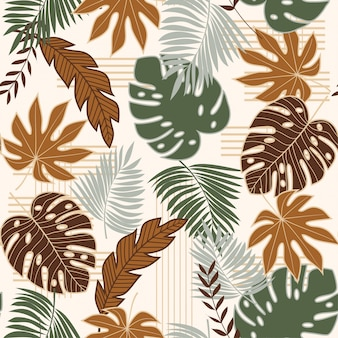 Tendencia de patrones sin fisuras con hojas tropicales verdes y marrones