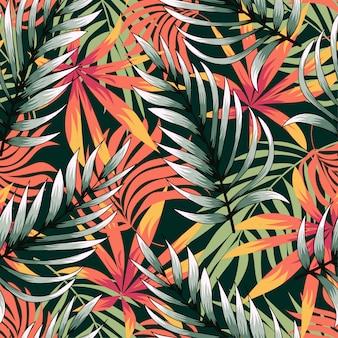 Tendencias de patrones sin fisuras abstractas con coloridas hojas y plantas tropicales sobre fondo verde
