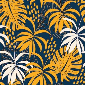 Tendencias de patrones sin fisuras abstractas con coloridas hojas tropicales y plantas en azul