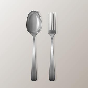 Tenedor y cuchara realista. juego de utensilios de cocina de plata en color plata.