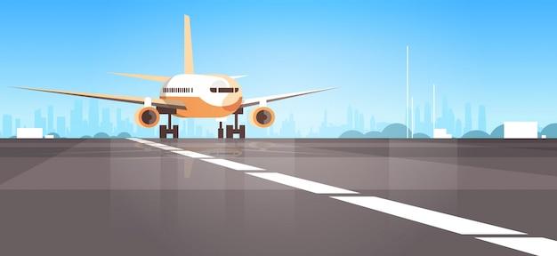 Terminal del aeropuerto con avión volando avión despegando de fondo del paisaje urbano