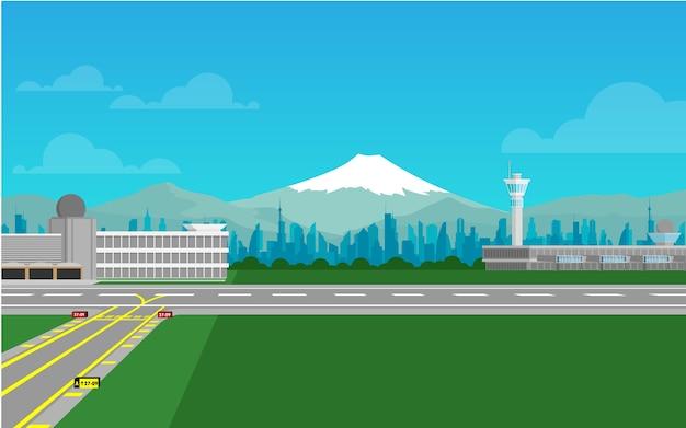 Terminal del aeropuerto con pista y montaña fuji al fondo.