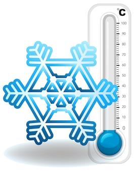 Termómetro y copo de nieve sobre fondo blanco.