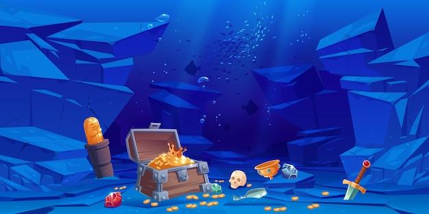 Tesoro en el fondo del mar, cofre con monedas de oro y corona, gemas de cristal, espada, ídolo de oro y copa con piedras preciosas