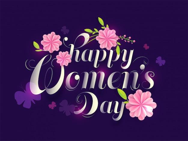 Texto de caligrafía feliz día de la mujer decorado con flores de corte de papel rosa y mariposas sobre fondo púrpura.