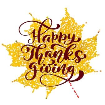 Texto feliz de la caligrafía de la acción de gracias en la hoja estabilizada amarilla.