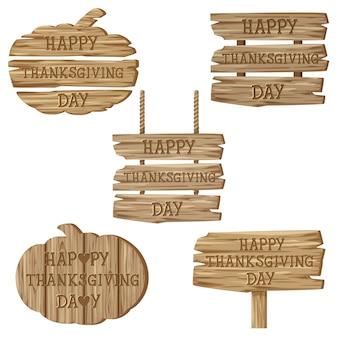 Texto feliz día de acción de gracias con variedad de carteles de madera