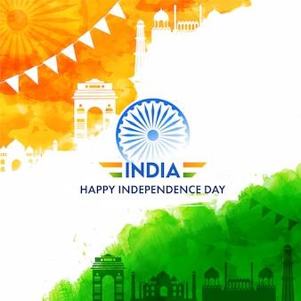 Texto de feliz día de la independencia de india con rueda de ashoka, azafrán y monumentos famosos de efecto acuarela verde sobre fondo blanco.