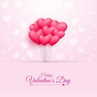 Texto de feliz día de san valentín de caligrafía y manojo de globos en forma de corazón rosa sobre fondo rosa.