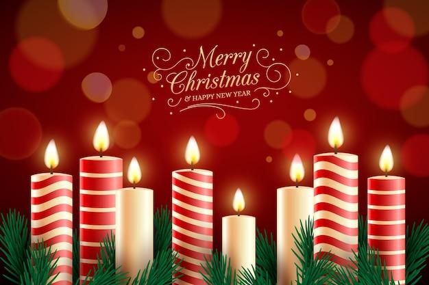 Texto de feliz navidad con fondo de velas