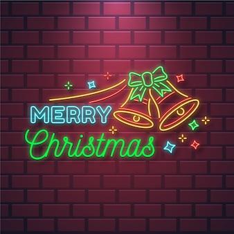 Texto de neón feliz navidad con campanas